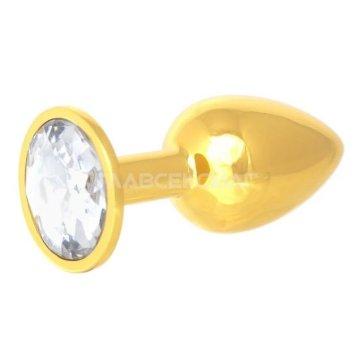 Золотистая анальная пробка с прозрачным кристаллом - 7 см.